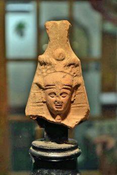 An Egypto-Roman terracotta head of a Pharaoh - 10.16 cm