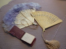 3 Doll accessories: 2 Doll fans of celluloid and ball booklet