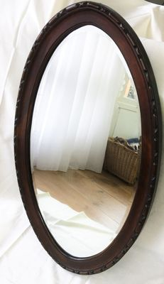 Facet cut oval hall mirror, almost 1 meter, in mahogany list - Holland - 19th century