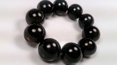 Huge black round modified beads Baltic Amber bracelet, 59 grams
