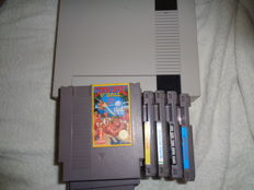 Nes 8 bit with 2 controllers including zapper and 13 games