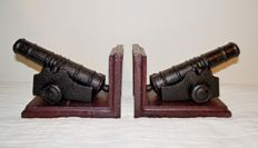 Book objects; Two bookends shaped like cannons - late 20th century