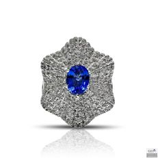 Ring in 18 kt white gold set with a sapphire of 1.82 ct, blue in colour and 84 diamonds of 0.99 ct, brilliant cut