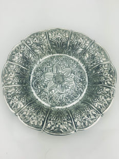 Silver dish with floral decoration, circa 1930.
