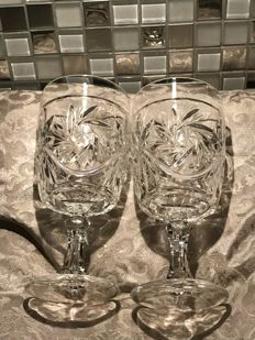 Richly carved Baccarat crystal - 2 crystal wine glasses.