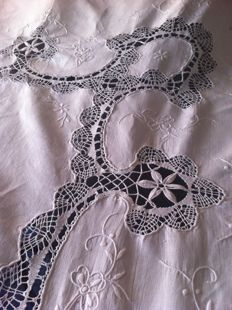 Lovely antique tablecloth decorated with lace and embroidery, from a grandmother's chest