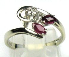 0.41 ct diamond and ruby ring, solid 14 kt / 585 white gold, size 53/16.8 mm