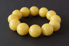 Baltic Amber bracelet in egg yolk colour, 53.16 gr.
