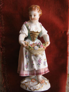 Meissen Figure of Gardener Child with Basket of Flowers