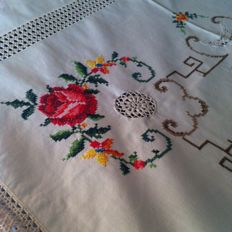 Sophisticated handmade tablecloth decorated with cross stitch and crochet embroidery