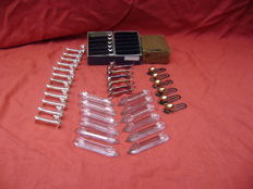 36 vintage knife rests and 6 beautiful clips.