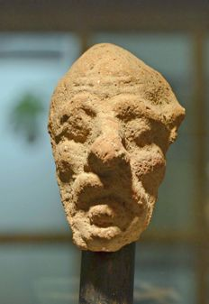 An Ancient Greek terracotta head of a grotesque - 5.08 cm