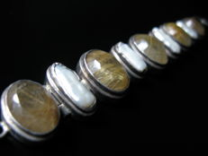 Silver bracelet with big sea water pearls and 2,8 cm facetted Rutilated Quartz. Messure 20 - 22 cm