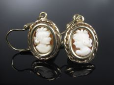 Gold stud earrings with cameo
