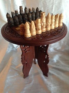 Vintage chess made of marquetry and carved in wood