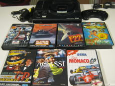 Sega Megadrive including 7 original and complete games : Flasback, F22 + Jungle book + Batlle Tank + Agassi tennis and GP