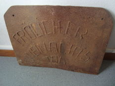 "Piece of tank in cast-iron engraved by welding ""FRÔLICHER WEINACHTS TAG"" by German prisoners  in France"