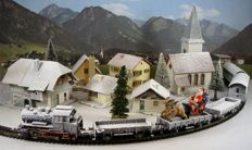 Fleischmann H0 - Starter set in Christmas livery with a steam locomotive Series BR 89, 3 flatcars, 2 passenger carriages, Father Christmas with sleigh, church, farmstead, 4 houses, Christmas trees, rails, points, lighting, connector wires, transformer and