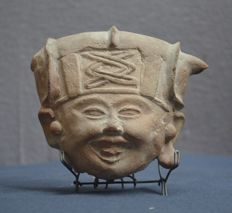 Pre-Colombian earthenware head of a richly adorned, smiling face -12.2 cm