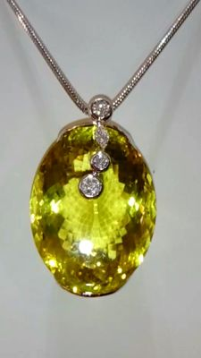 Stunning 18 kt white gold pendant with rare 129 ct lemon amethyst and diamonds totalling 0.36 ct ***No reserve***