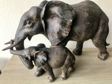 Very large sculpture of an elephant mother with calf
