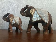 Set of two solid wooden elephants, hand-carved - with foil copper fittings and inlaid with mother-of-pearl