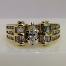 unique marquise and baguette cut yellow 14ct gold and diamond ring