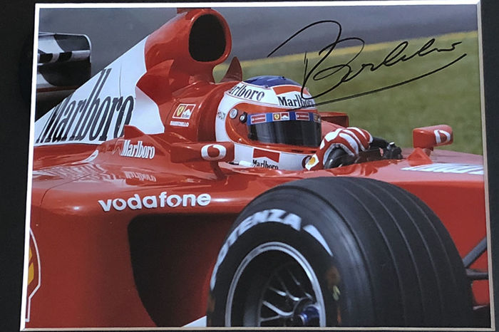 Nice framed image, personally signed by Rubens Barrichello