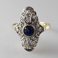 14 kt gold Art Deco ring with old cut diamonds and blue sapphire in platinum