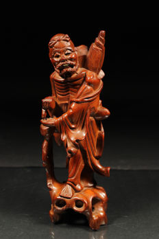 Hardwood sculpture of the immortal Tieguai Li - China - early 20th century