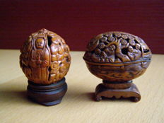 Two HEDIAO tooled walnuts - China - 2nd half 20th century