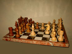 Big vintage chess game with wooden pieces and marble chessboard