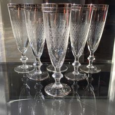 6 very fine crystal champagne flutes decorated with silver