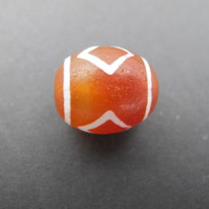 Red agate painted bead. 18.4 x 15.7 mm; 6.7 g