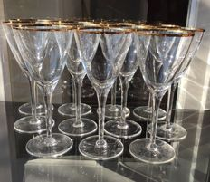 Lot consisting of 11 fine crystal glasses decorated with 24kt gold