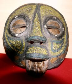 Large old African wooden mask; embellished with beads