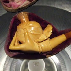 antique meerschaum smoking pipe of a ladieshand holding a rose