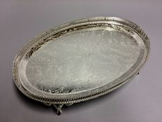 Silver plated oval serving tray with floral decor on 4 claw feet, England, mid 20th century
