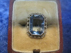 Vintage ring with light blue topaz