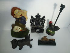 5 Cast iron utensils - flagpole holder, nutcracker & door stoppers