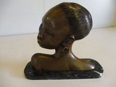 Bronze relief sculpture, African woman