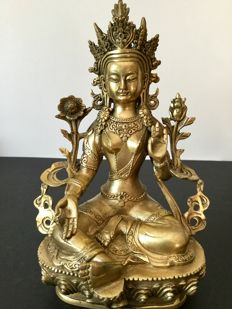 Depiction of Green Tara in gold-patinated brass - Nepal - early 21st century