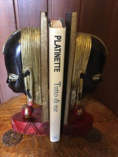 Wooden bookends in the shape of an African woman face