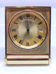Small travel alarm clock JAEGER LECOULTRE, new and in its original box.