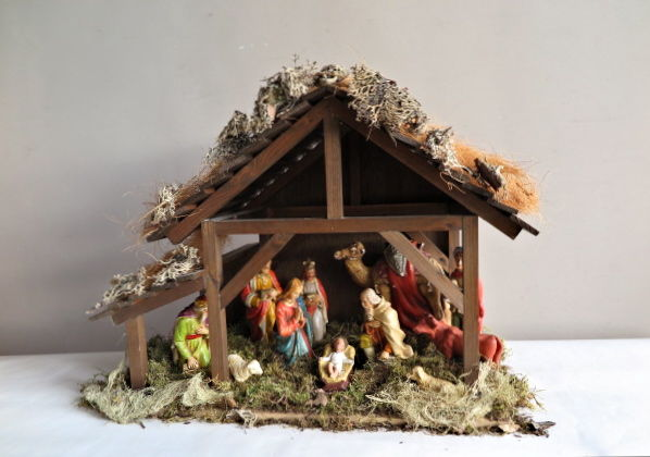 Large nativity scene with antique plaster group of figures