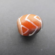 Red agate bead painted in nepal. 17.9 x 15.2 mm; 6.1 g