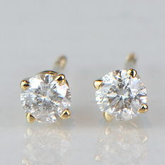 Gold stud earrings with solitaire diamonds totalling 0.33 ct -approx. 35 mm