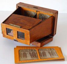 Wooden folding viewer in the shape of a case with 3 translucent photos