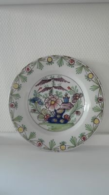 Delft earthenware plate with multicoloured decor
