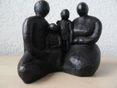 "A beautiful burnished sculpture with a monogram, black patinated, ""Het gelukkige gezin"""